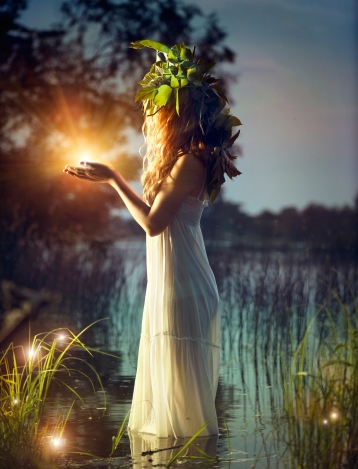 Fantasy girl taking magic light in her hands. Mysterious Night s